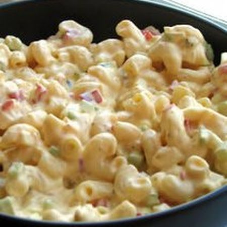 Amish Macaroni Salad:*2 cups uncooked elbow macaroni  *3 hard-cooked eggs, chopped  *1 small onion, chopped  *3 stalks celery, chopped  *1 small red bell pepper, seeded and chopped  *2 tablespoons dill pickle relish  *2 cups creamy salad dressing (e.g. Miracle Whip)  *3 tablespoons prepared yellow mustard  *¾ cup white sugar  *2¼ teaspoons white vinegar * ¼ teaspoon salt  *¾ teaspoon celery seed