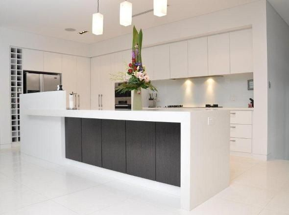 Kitchen love, love minimalist white with colour accent on breakfast bar and white polished porcelain floor tiles and the WINE RACK!