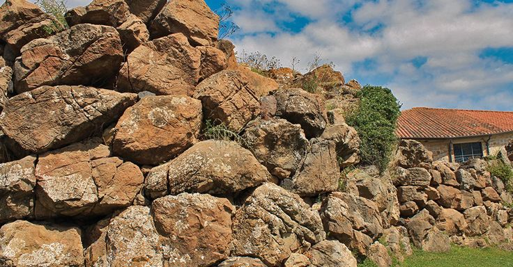 The Nuraghe stands between two churches It offers an amazing view over the Golf of Palmas