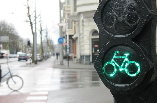Yep, you can bike now. Although to be frank, most Dutchies don't wait for the red bicycle light to go green, and cross the street 'kamikaze style'. It takes an advanced bicycler to do that safely, so don't even think about it! Besides, you're probably in no rush if you're visiting the country, so you can safely wait for the light to go green. #greetingsfromnl