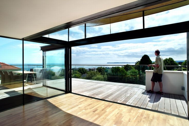 Sunflex UK's SVG sliding door installed by Olsen