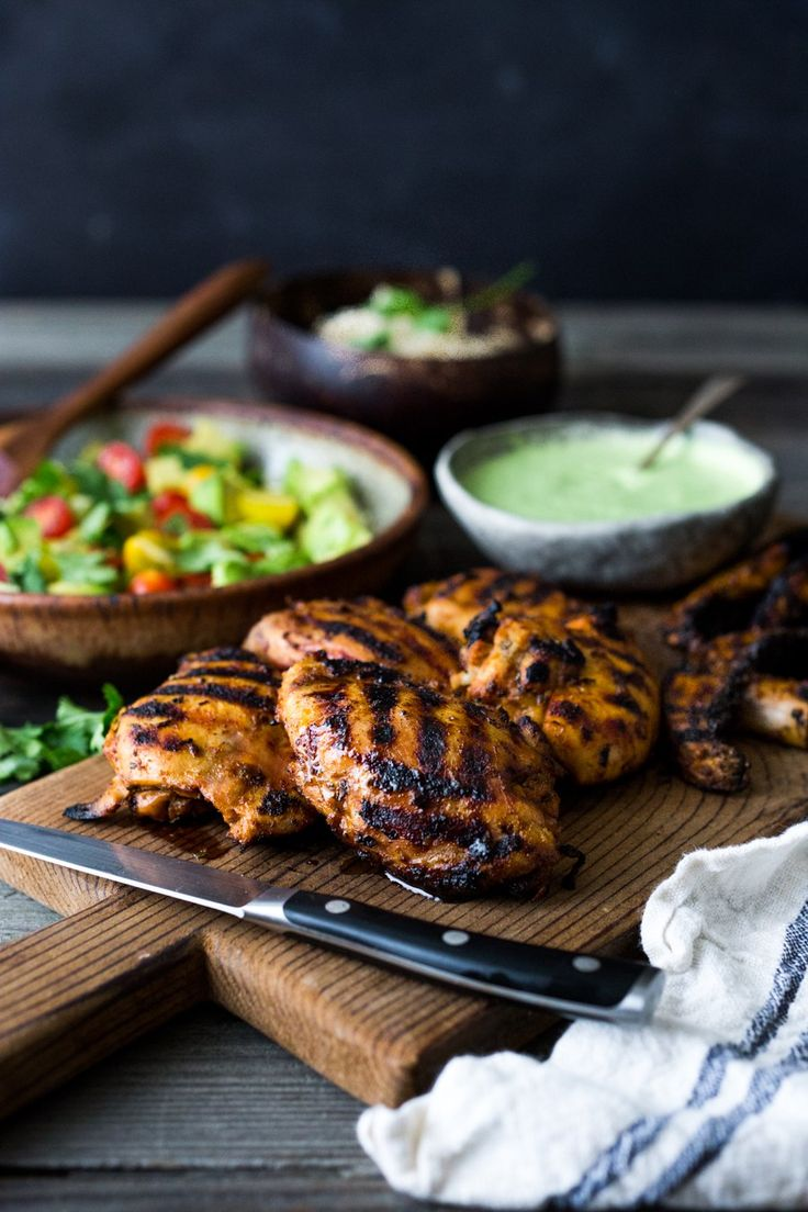 Simple, delicious Grilled Peruvian Chicken (Pollo a la Brasa) with Green Sauce and Avocado Tomato Cucumber Salad. Can be made in 40 minutes- perfect for weeknights!