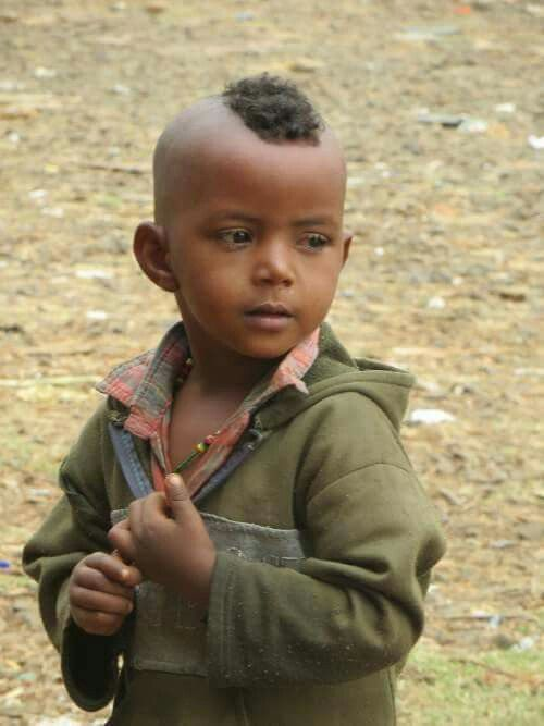 A Little Boy Standing At Mettu Bus Station Ethiopia