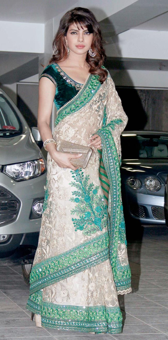 Priyanka Chopra looks stunning in beige-green sari with her hair let down at Aamir Khan's Diwali bash.
