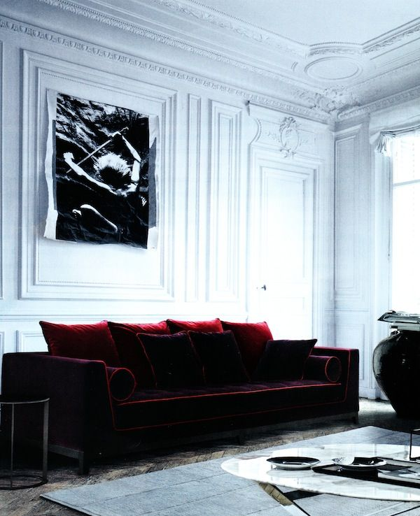 Beautiful old white moulding/ architecture coupled with a gorgeous dark velvet sofa...yep!