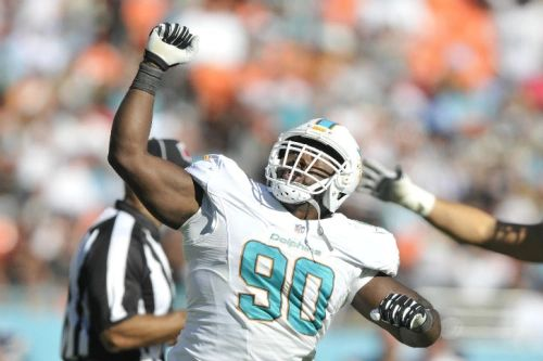 Nov 2, 2014; Miami Gardens, FL, USA; Miami Dolphins defensive tackle Earl Mitchell (90) celebrates after sacking San Diego Chargers quarterback Philip Rivers (17) at Sun Life Stadium. The Dolphins won 37-0. Mandatory Credit: Brad Barr-USA TODAY Sports