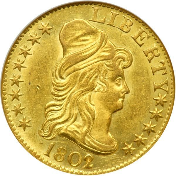 1802/1 $5 Capped Bust. NGC MS62 A nicely struck example with light golden toning. This is a very well defined example for the series with appreciable detail over the peripheries and central devices and the striking appearance of its 2 over 1 overdate. Any grade-defining abrasions are small and not in the least distracting. The coin is devoid of adjustment marks. Say what you will, collectors prefer early gold pieces to be this way. The 1802 is one of the more readily obtainable early Half…