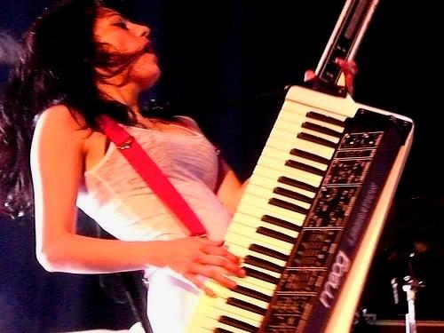 Moog Liberation Keytar being rocked by a lovely Joan Jett look-a-like