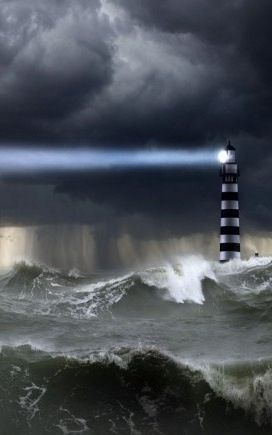 Black clouds, light house & angry waves. Awesome..!!