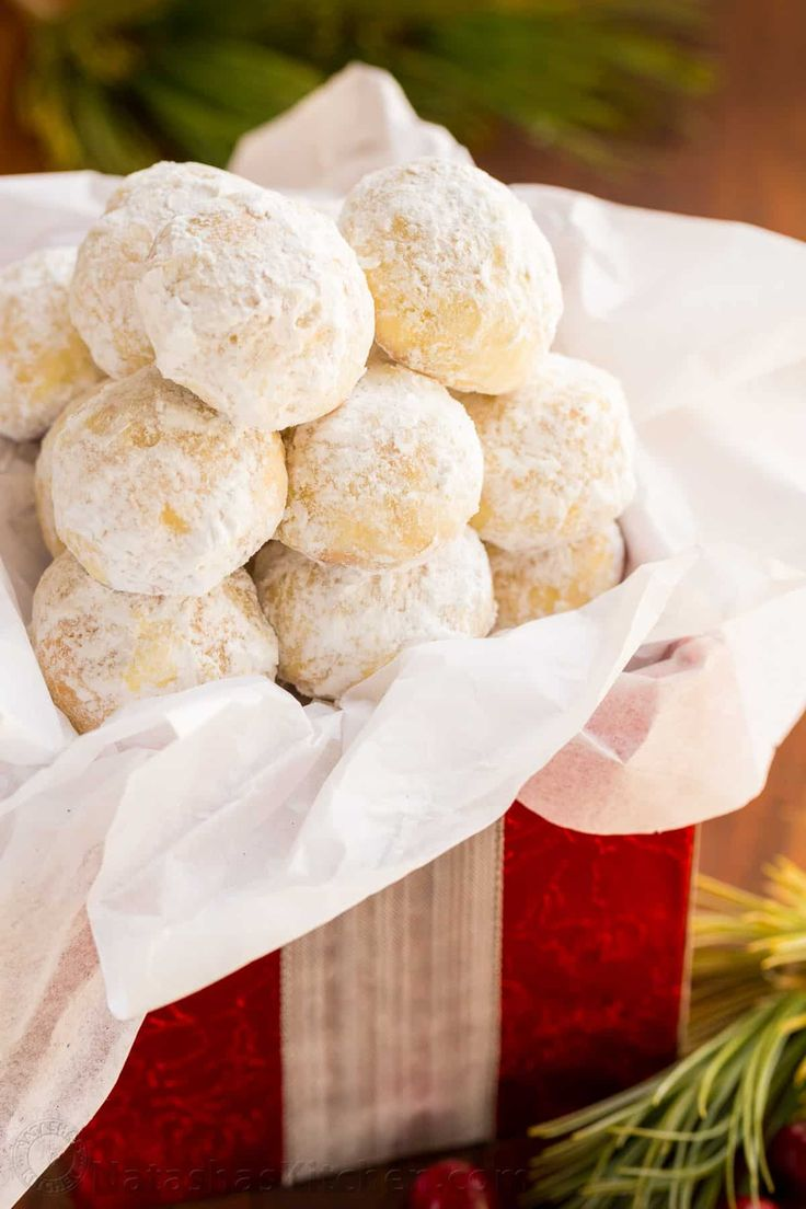 Darling almond snowball cookies that melt in your mouth! Almond Snowball Cookies are perfect for Christmas cookie platters and gifting (make-ahead recipe!)