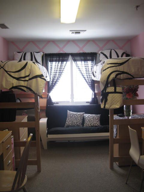 Dorm Rooms individual chairs under bed, tvs on dressers, curtains for privacy