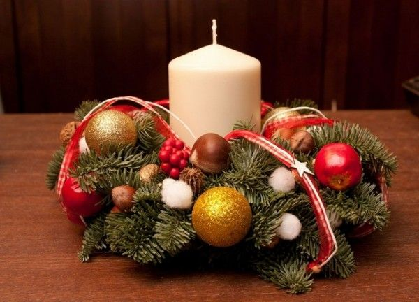 christmas centerpiece - white pillar candle, gold and red ornaments