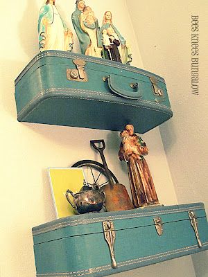 Vintage suitcase shelves.  You can always find old suitcases at Goodwill.  What a cool idea!