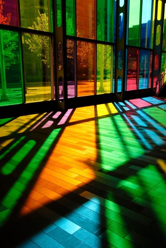 "Stained glass windows play with the senses in this example of literal transparency. As Roger Vanderheide expressed, ""Light is the expression of structure,"" and the pockets of color interrupted by the shadows of beams are very telling about the structure of the building itself, as there is ""no good light without proper darkness."""