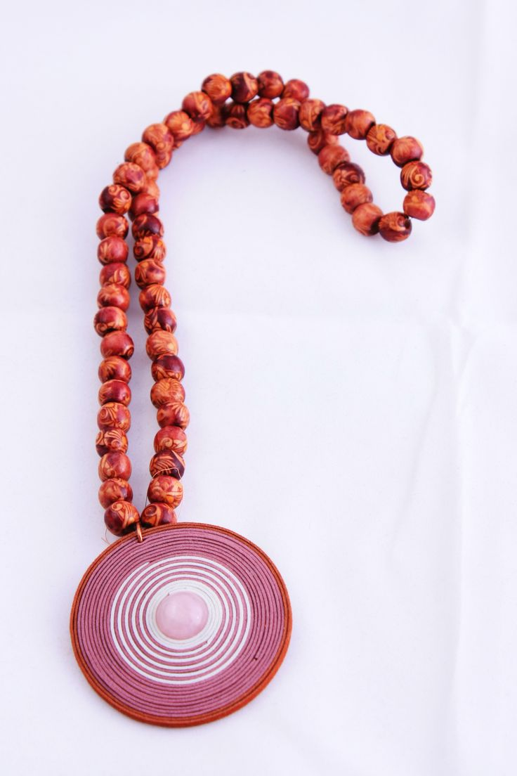 wood pearls and rose quarz in the middle 9 EUR / 2500 HUF