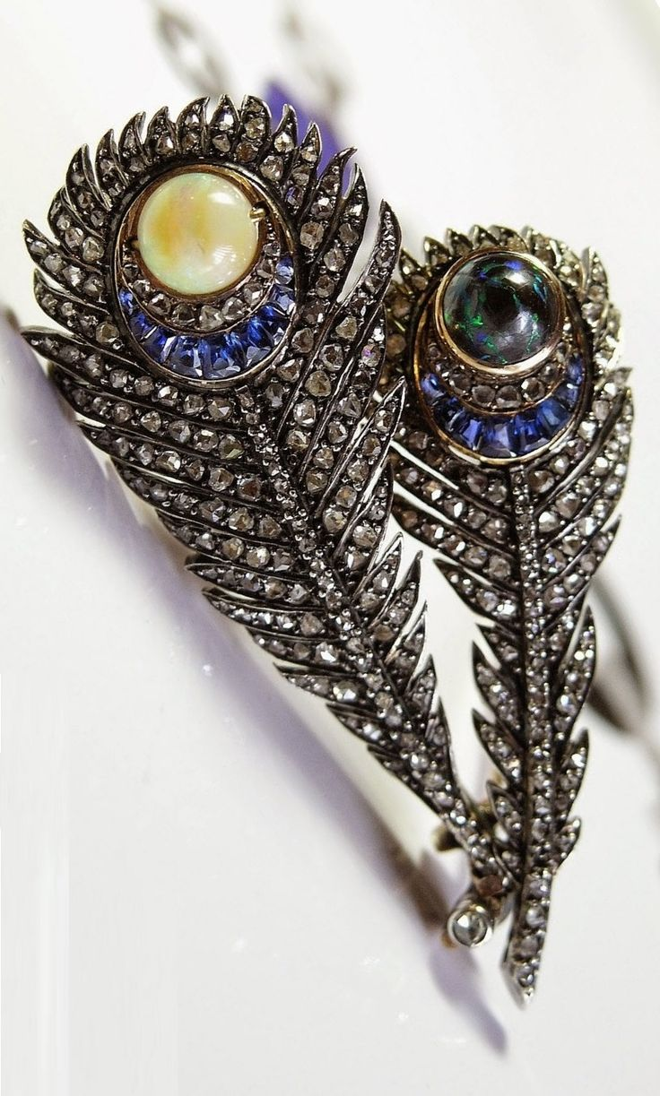Mellerio dits Meller - An antique gold, opal, sapphire and rose-cut diamond peacock feather brooch, late 19th century. #MellerioDitsMeller #antique #brooch