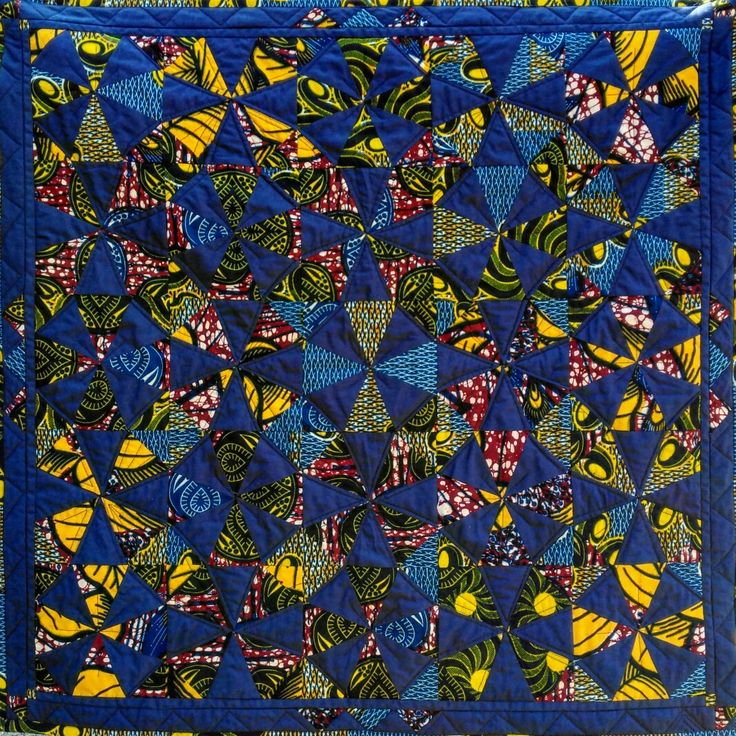 "Kaleidoscope patchwork quilt made with african print fabric bought in Conakry, Guinea. Machine quilted. Made by Eleanor Hannan May 2016. Final size 32"" x 32""."