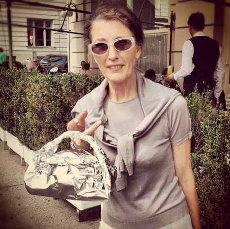A lady I met in Vienna a few years back, with her al-foil doggy bag, plus my note to restaurant owners about doggy bags.