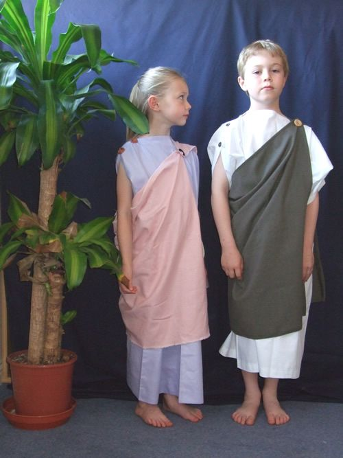 Simple togas-- are improved by gold cording for belt, embellishment