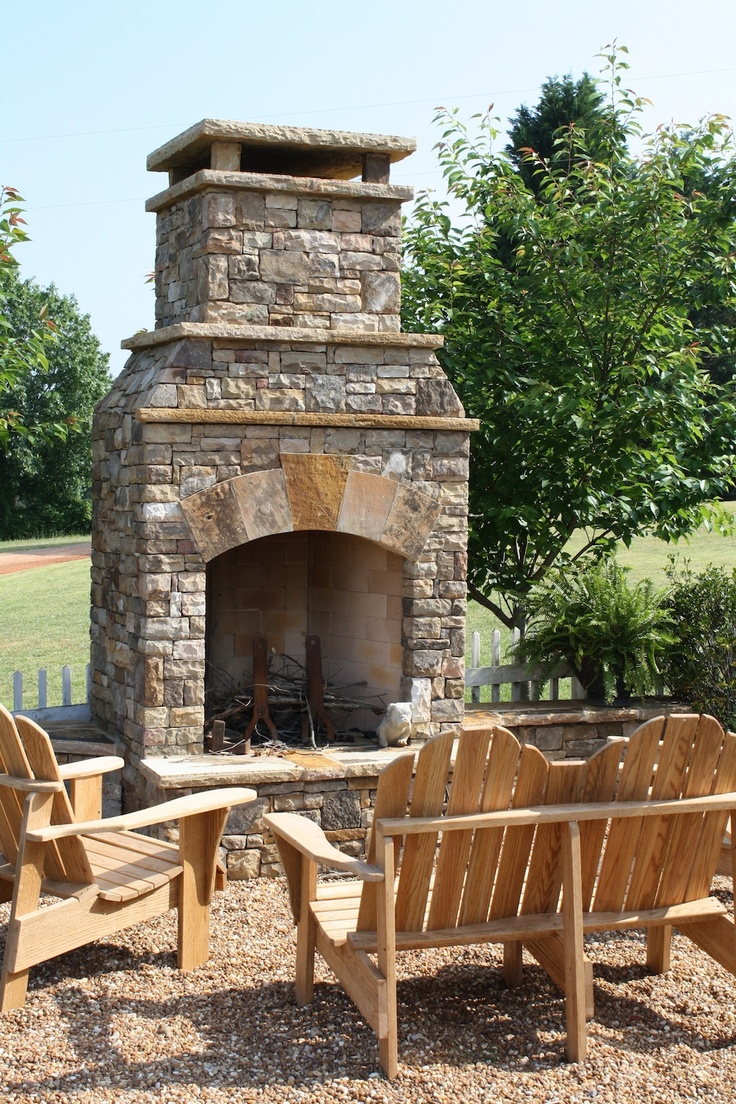 Outdoor Seating Area With Stacked Stone Fireplace Outdoor Fireplaces
