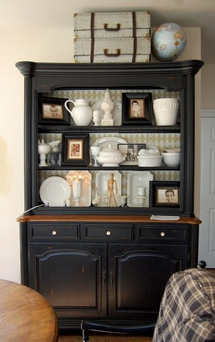 I love this hutch! I'm trying sooooo very hard to talk my husband into letting me paint ours. He's already agreed to let me paint the dinningroom table and chairs, but not the hutch.