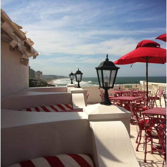 Enjoy a cocktail at Lighthouse bar terrace, Oysterbox, Durban.