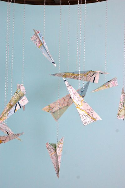 Paper airplanes of maps-- so cute for a little boys room.