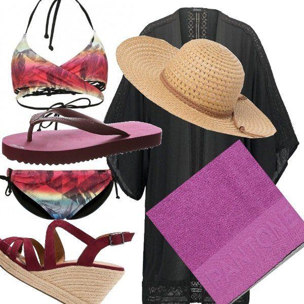 Look per una giornata di mare. Costume due pezzi con arcobaleno di colori, copricostume nero con capello in rafia che riporta il motivo della zeppa del sandalo e per la spiaggia infradito viola che richiama lo stesso colore dell'asciugamano