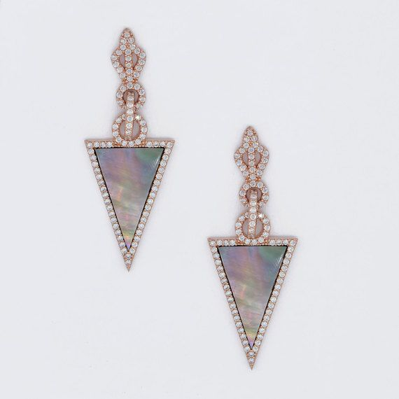 These are earrings that i designed them to show a woman who is graceful and charming like a queen. I created 3 points to the upside inspiring from
