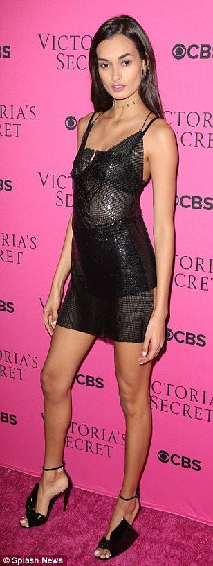 Stunning! Gizele Oliveira was slinky chic in a see-through LBD that showed off her black u...