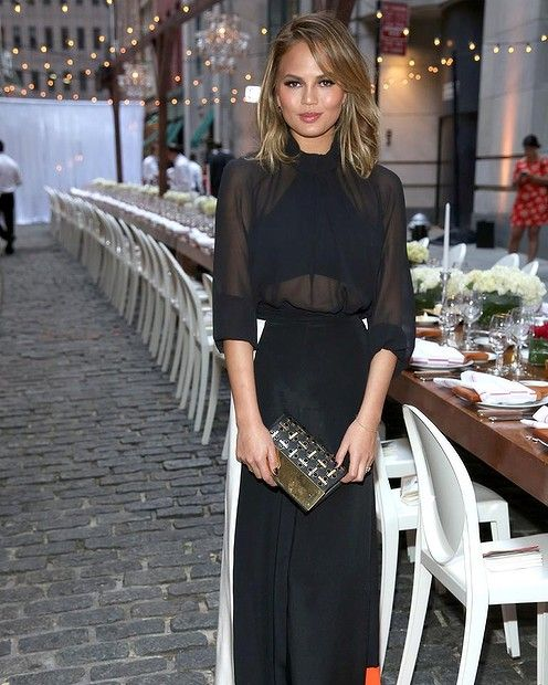 Chrissy Teigen attends Chrissy Teigen And Stella Artois host Belgian National Day Celebration to kick off the launch of The Butcher. #chrissyteigen #smh #lifeandstyle #fashion