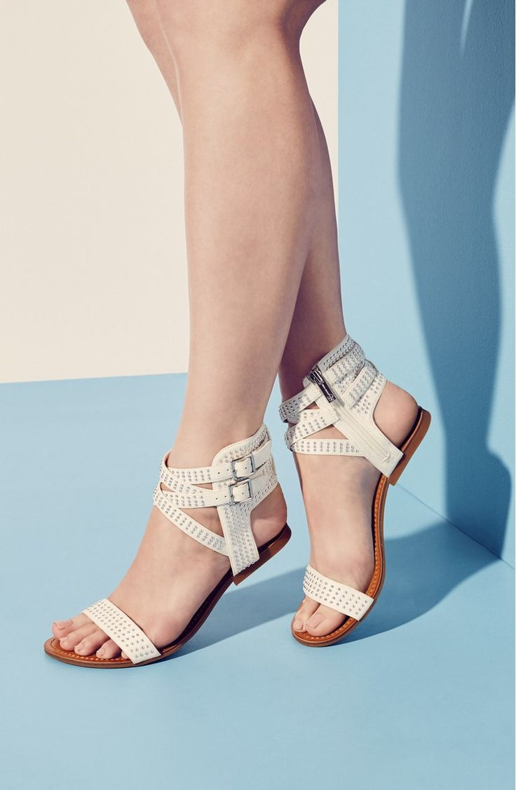 Tiny, gleaming studs amp up the trend-right appeal of this gladiator-inspired flat sandal fashioned with wraparound ankle straps.