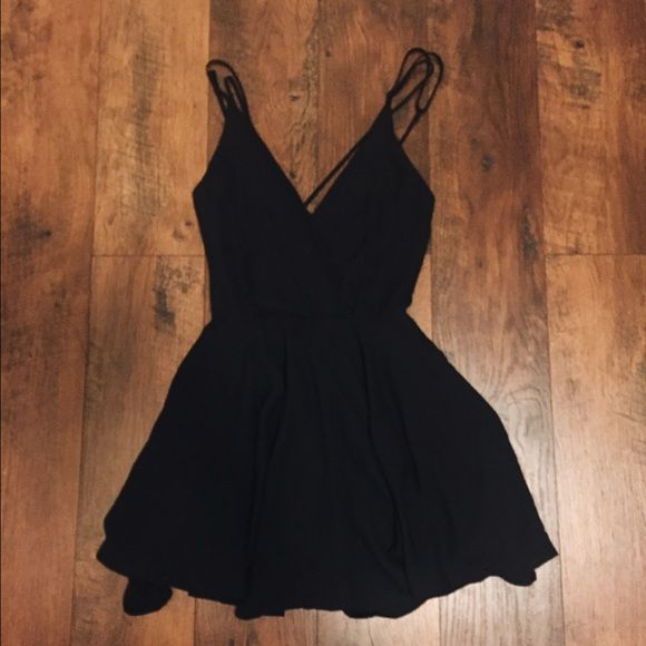 Little black dress Wore this for Homecoming , fingered I would never wear it again. Very cute from Urban Outfitters. Straps crossed back. Needs a little cleaning. Urban Outfitters Dresses Mini
