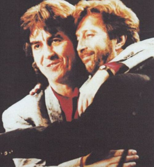 """George Harrison and Eric Clapton, onstage in Japan, December 1991.  The tour began on 1 December 1991.  """"""""I finished the year by touring Japan with George Harrison. He and Olivia had been really kind to me over the last few months [following the tragic..."""