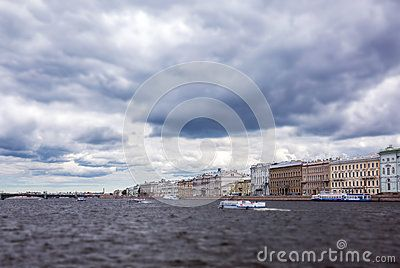 A tilt and shift view of usual dark water of Neva river under thunderstorm clouds in Saint Petersburg, Russia.