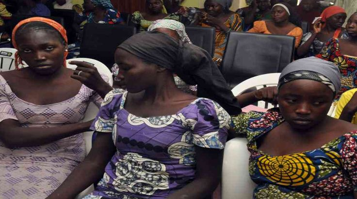 """Nigerian Military Rescues 76 Schoolgirls After Boko Haram Attack. Read more. Visit Nigeria Rendezvous on - http://nigeriarendezvous.com/nigerian-military-rescues-76-schoolgirls-after-boko-haram-attack/ - http://nigeriarendezvous.com/wp-content/uploads/2018/02/family-members-react-as-they-embrace-a-relative-R-one-of-the-82-schoolgirls-released-after-captivity-at-the-hands-of-Boko-Haram-for-three-years-in-Abuja-Nigeria.jpg - """"Everybody is celebrating their coming with songs a"""