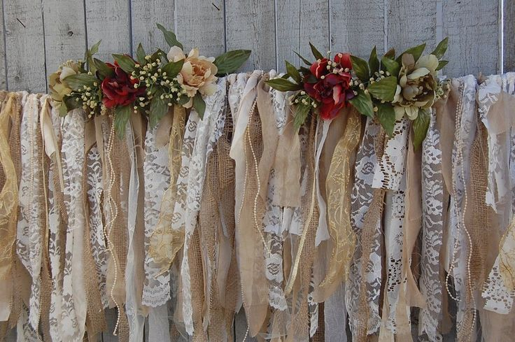 Christmas garland, with the rustic look of a French flea market. Hand tied with tattered vintage tea-stained lace, gold crinkle crepe, gold striped satin, burlap, gold satin trim, ivory and white lace