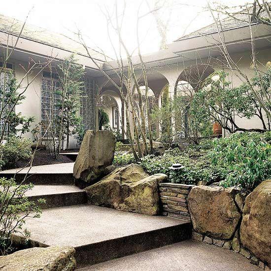 Blend natural and artificial elements to give your yard an established, comfortable look: http://www.bhg.com/gardening/landscaping-projects/landscape-basics/front-yard-landscape-secrets/?socsrc=bhgpin032314blendnatureandartpage=13