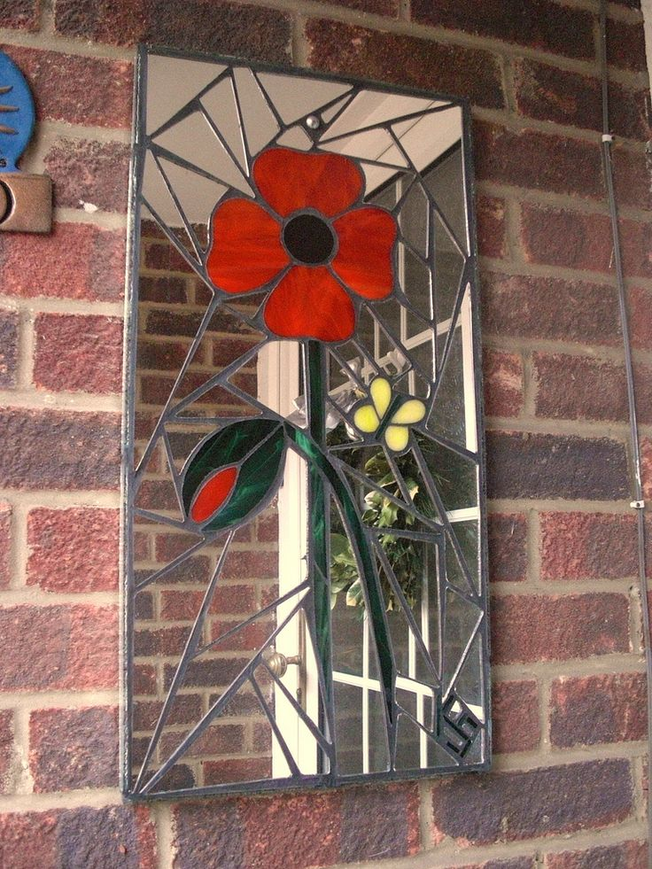 Mosaic garden mirror (31 x 62cm / 1' x 2'). Handmade using stained glass and recycled mirror.