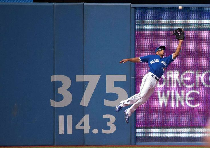 Soaring catch - Toronto Blue Jays left fielder Ben Revere catches a ball during the fourth inning in a game against the Kansas City Royals at Rogers Centre on Aug. 1 in Toronto, Canada. - © Nick Turchiaro/USA TODAY Sports