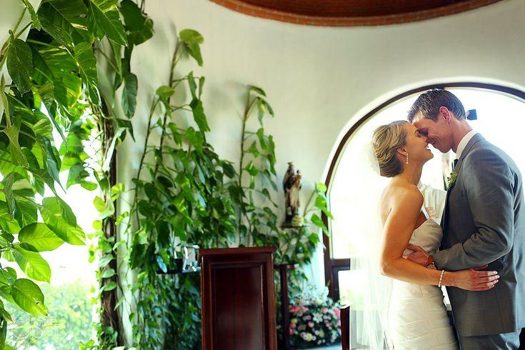 Newlyweds at their destination wedding ceremony at Capilla de Nuestra Señora del Carmen in Playa del Carmen. Mexico wedding photographers Del Sol Photography.
