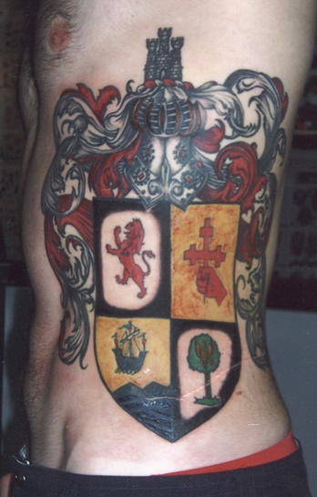 Nick; Tattoo Artist Perth   Darkside Tattooing - Family Crest simular to what Dave wants but on his arm
