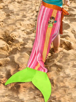 Let your little mermaid dress up for undersea adventures with this mermaid tail towel! A shaped fin is added to the end of a beach towel to make this fun project. Free project tutorial and pattern.