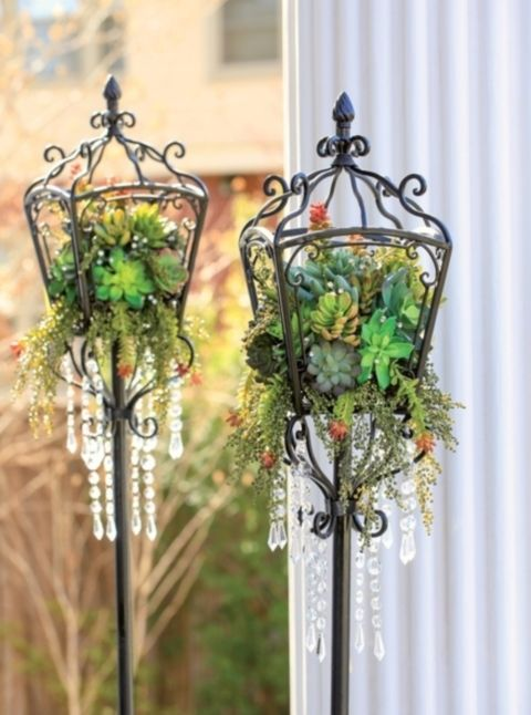 Not crazy about the hanging crystals but would be cute with a candle in the middle.