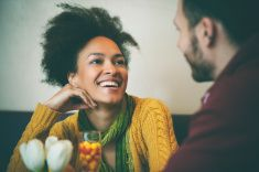 Young couple talking at coffee shop stock photo