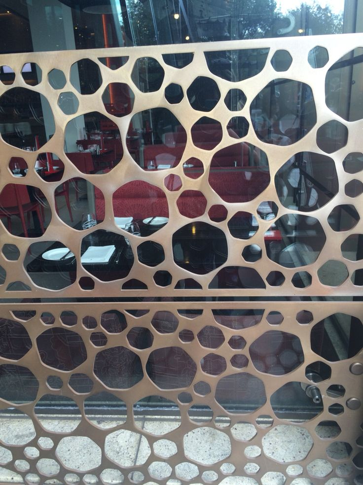 Metal laser cut panels with glass