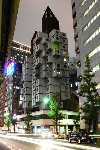 Capsule Tower - Tokyo - Japan. This is one of my favorite buildings in the world, as it is symbolic of the Metabolism movement. However, it is slated to be torn down sometime soon and is almost devoid of tenants.