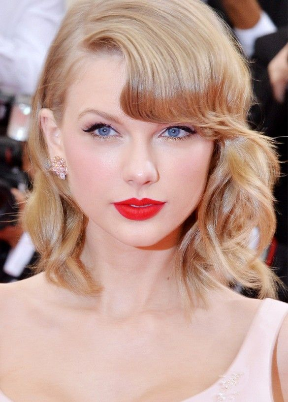 Taylor Swift stuns with a wavy bob and matte red lipstick.