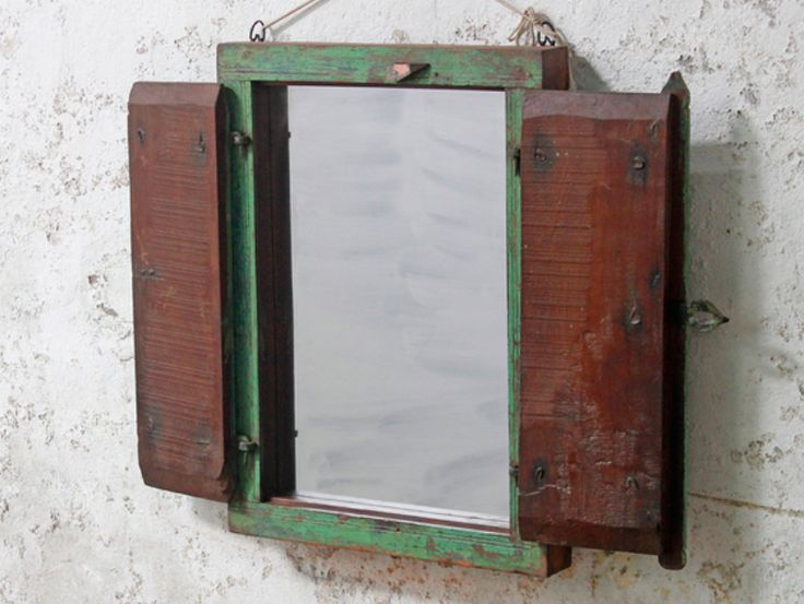 A beautiful pale green 'window' mirror with a desirable shabby chic distressed surface finish. This heavy painted teak wooden mirror is made from an entire reclaimed antique window frame and shutters. #vintage #mirror #unique #furniture #homedecor #homestyle