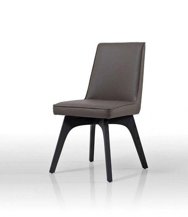 Chaise design Alaska de salle à manger. Chaise au lignes très design. Piètement en hêtre et revêtement de l'assise en cuir ou tissu.